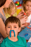 Child dough play in school. Plasticine for children. Royalty Free Stock Images