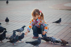 Child and doves Stock Photo
