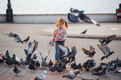 Child and doves Royalty Free Stock Photos