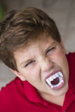 Child with Dracula teeth Stock Photography