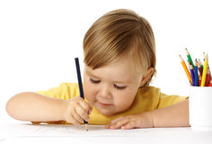 Child draw with color crayons Royalty Free Stock Image