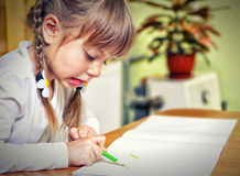 Child draw with colorful crayons Royalty Free Stock Image