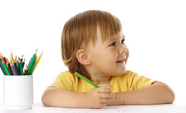 Child draw with crayons. Cute child draw with crayons, isolated over white stock photos