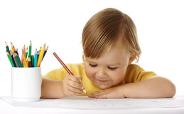 Child draw with crayons. Cute child draw with crayons, isolated over white stock images