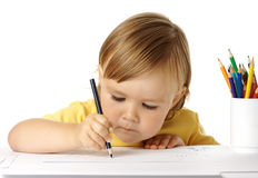 Child draw with crayons. Cute child draw with colour crayons, isolated over white stock image