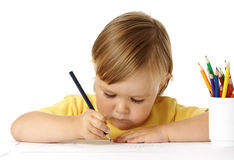 Child draw with crayons Royalty Free Stock Images