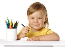 Child draw with crayons and smile. Cute child draw with colorful crayons and smile, isolated over white royalty free stock photos
