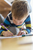 Child draw a drawing on the floor stock photography