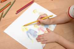 Child draw  family Stock Images
