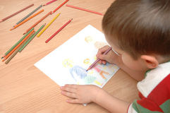 Child draw family Stock Photography