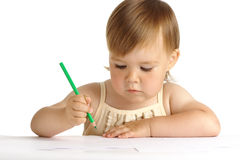 Child draw with green crayon Royalty Free Stock Photos