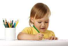 Child draw with green crayon Stock Images