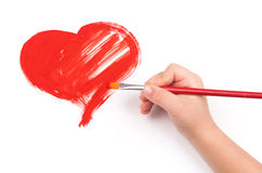 Child draw a heart. On paper royalty free stock photos