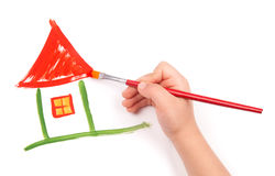 Child draw a home. Child's hand  draw a home Stock Image