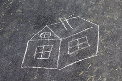 Child draw house. On asphalt royalty free stock images