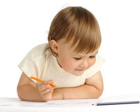 Child draw with orange crayon Stock Images