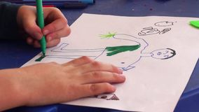 Child draw a painting stock video footage