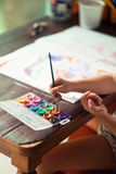 Child draw picture, color palet Royalty Free Stock Image