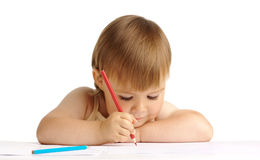 Child draw with red crayon Stock Photo