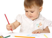 Child draw with red crayon. Cute child draw with red crayon, isolated over white royalty free stock photos