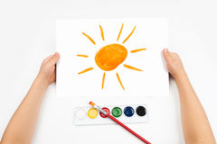 Child draw the sun watercolors Stock Photography