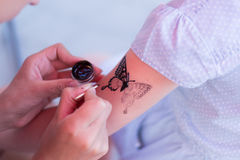 Child draw a tattoo Royalty Free Stock Photography
