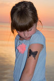 Child draw a tattoo Stock Images