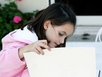 Child drawing. A child drawing pictures in the garden Stock Photos