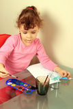 Child drawing. With watercolors stock image
