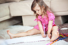 Child drawing. Alone at home royalty free stock image
