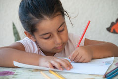 Child drawing 3. Child coloring in a drawing with colorful pencils Royalty Free Stock Photo