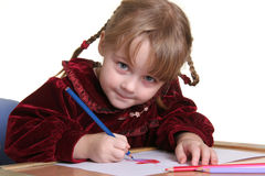 Child drawing. Young pretty girl learn drawing with pencil Royalty Free Stock Photo