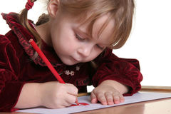 Child drawing. Young pretty girl learn drawing with pencil Stock Photos