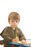 Child drawing. 3 year old boy drawing with a crayon Royalty Free Stock Photo
