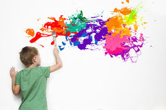 Child drawing an abstract picture. Gifted child drawing an abstract picture with colorful splatters royalty free stock images