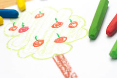 Child drawing, apple tree , selective focus. Child crayon drawing, apple tree , selective focus stock photo