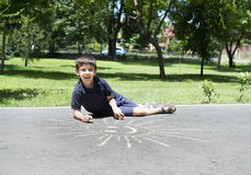 Child drawing on asphalt Royalty Free Stock Photo