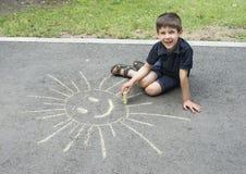 Child drawing on asphalt Stock Image
