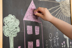 Child drawing on a blackboard Royalty Free Stock Photography