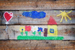 Child drawing on the boards. Child drawing on to the old boards royalty free stock images