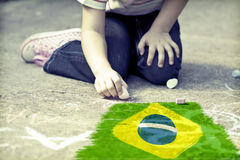 Child drawing Brazil`s flag Stock Image