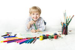 Child drawing with brush in album Royalty Free Stock Photography