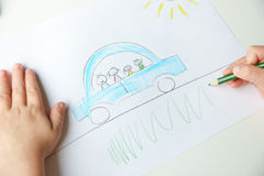 Child drawing a car Royalty Free Stock Images