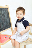Child Drawing With Chalk Stock Image