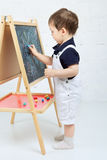 Child Drawing With Chalk Royalty Free Stock Photos