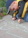 Child drawing a chalk. On asphalt stock images