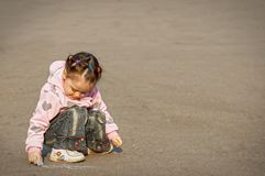 The child drawing a chalk on asphalt Stock Photography