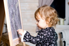 Child drawing with chalk Royalty Free Stock Image