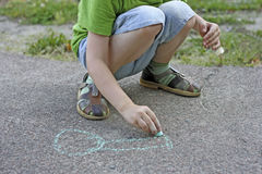 Child drawing with chalk. Royalty Free Stock Photos