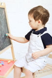 Child Drawing With Chalk Royalty Free Stock Photography